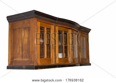 Old brown wooden kitchen cabinet suspended. Side view. With glass inserts in the door