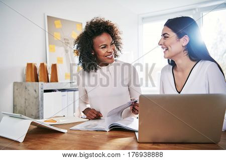 Two Happy Businesswomen Laughing Together