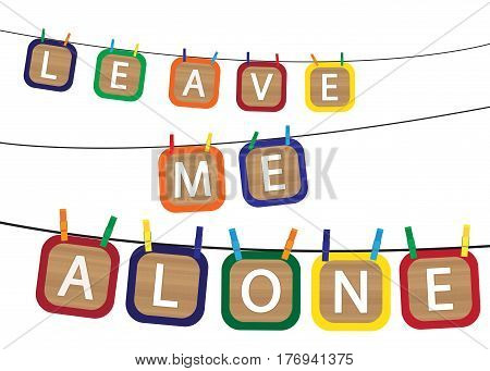 Kids blocks spelling leave me alone on a washing line isolated on a white background