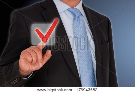 Manager touching screen and red checkbox with finger