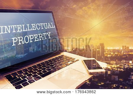 INTELLECTUAL PROPERTY: Grey screen laptop computer. Vintage effects. Digital Business and Technology Concept.
