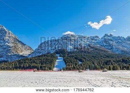 Pista Nera ski resort on a sunny winter afternoon, Sappada Italy.