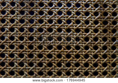 A complicated but beautiful woven wood texture.