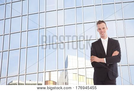 Young businessman in front of office building