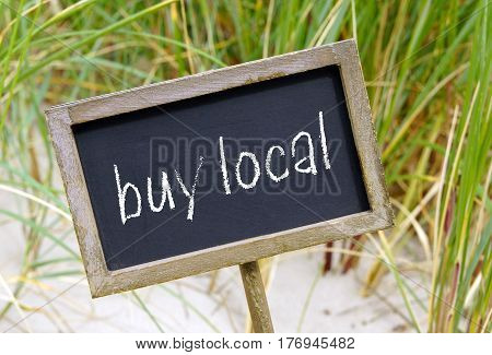 buy local - wooden chalkboard with text