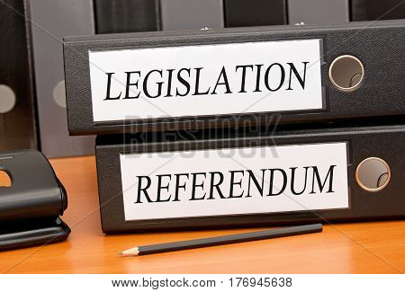 Legislation and Referendum - two binders on desk in the office