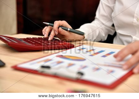 Businesswoman Using Red Calculator
