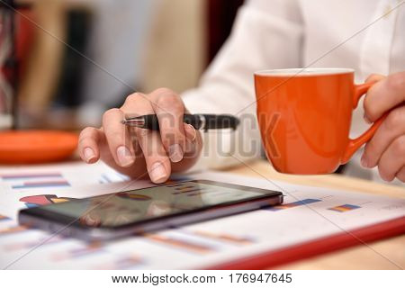 Trader Woman Analyzing Report On Mobile Phone Screen. Close Up