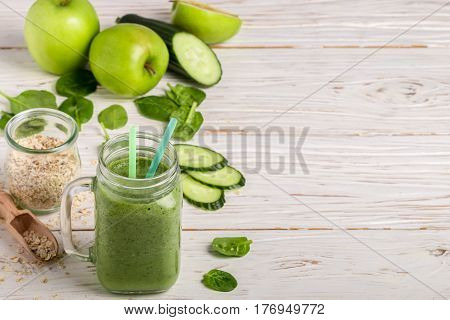Fresh Green Smoothie From Fruit And Vegetables For A Healthy Lifestyle And Ingredients For Making Di