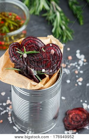 Healthy Beetroot Chips  With Salt And Rosemary. Snack For Gourmets. Baked Beet Slices.selective Focu