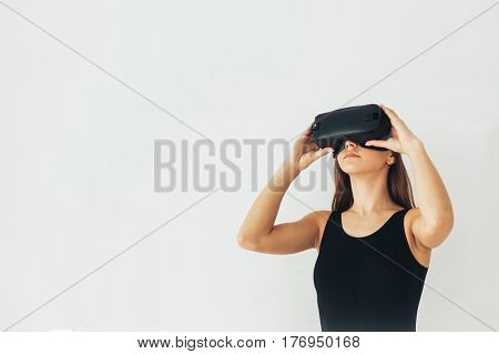 Young woman with glasses of virtual reality. Future technology concept. Modern imaging technology.