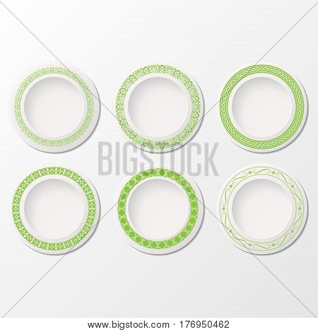 Set of six white plates with different green patterns