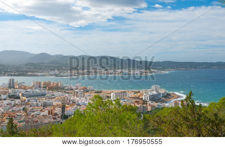 View from the hills in St Antoni de Portmany and surrounding area in Ibiza. Clear November day in the bay.  Islands near Spain. Hotels along the beach, places to stay.