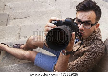 A photographer takes pictures (Creativity hobbies work freelance concept)