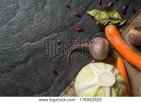 Beets, Carrots And Cabbage During Cooking. Composition On A Dark Background.