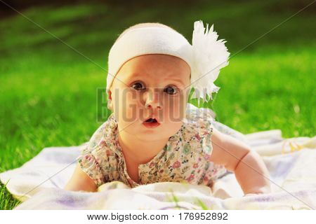 Portrait of amazed small baby girl. Nature surprise holidays childhood concept.