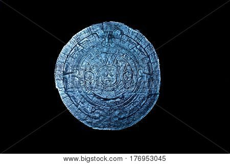 glass and glowing mayan calendar on blackground