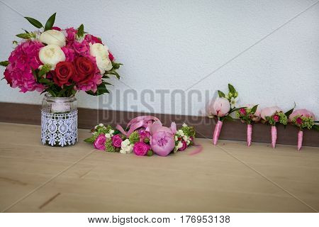 Bride's bouquet of peons and roses, flower hair decor and beautiful boutonnieres