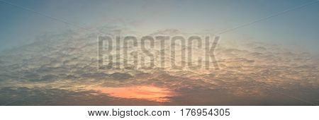 Red sunset with many small fleecy clouds