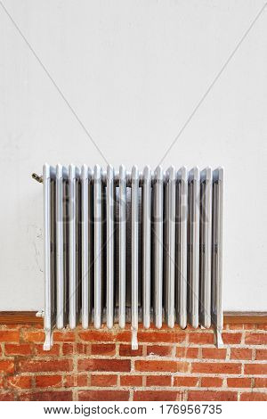 Old Heating Radiator On A Wall.