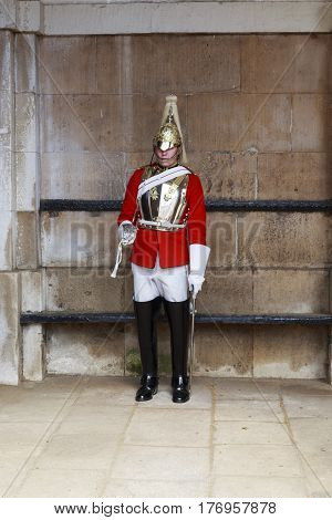 LONDON, GREAT BRITAIN - MAY 12, 2014: This is one of the guards in the archway of the Royal Horse Guards Building.