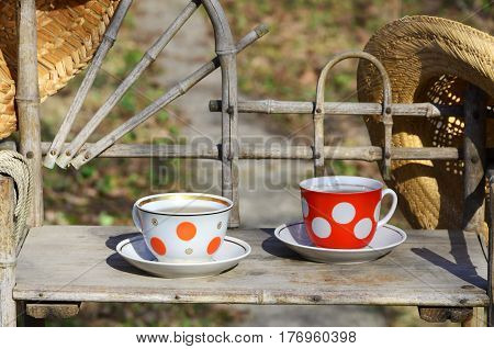 Rustic Still Life With A Cups Of Tea And Straw Hats