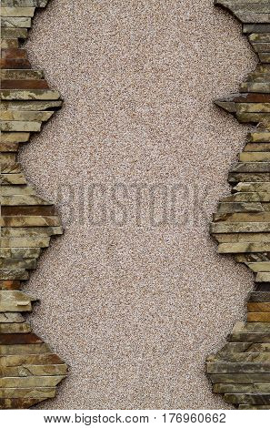 Plastered Concrete Wall With A Frame Of Flat Stones