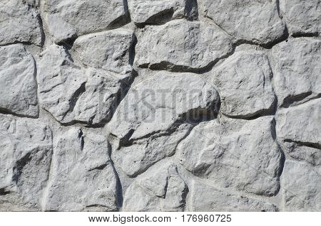 Texture Of Concrete Fence With Relief And Texture Like A Stone Wall