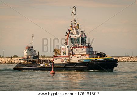 Venice Italy - May 20 2016: Tugboat used to tow the cruise ships in the lagoon to St. Mark's Square.