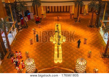 Abu Dhabi, United Arab Emirates - April 21, 2013: aerial view of monumental main entrance in luxurious hotel and landmark Emirates Palace. Luxury travel concept. Middle East travel holidays.