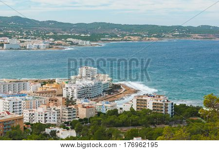 View from the hills into St Antoni de Portmany & surrounding area in Ibiza.  Clearing November day in the bay.  Islands near Spain.  Hotels along the beach, places to stay.