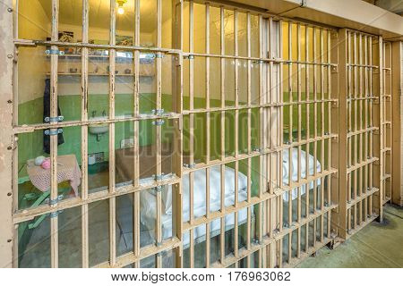 San Francisco, California, United States - August 14, 2016: Alcatraz prison main room with three rows of cells on three levels. Many tourists visiting on tour every day. Historical site landmark.