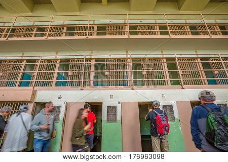 San Francisco, California, United States - August 14, 2016: Alcatraz isolation cells on ground level. All cells are single with armoured door and steel barred windows. The D-Block with isolation cells