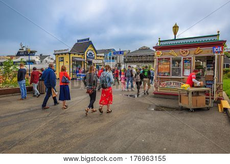 San Francisco, California, United States - August 14, 2016: people at Fisherman's Wharf at Pier 39 along the Embarcadero. San Francisco cityscape.
