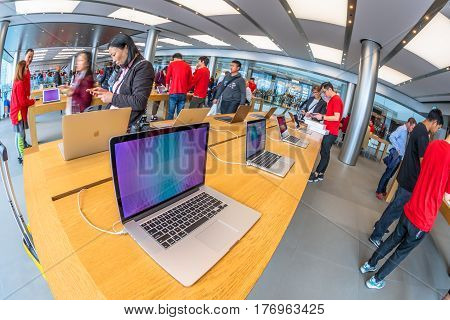Hong Kong, China - December 4, 2016: close up mac book laptop inside Apple store, IFC Mall, Central District. Apple is world leader in consumer tablets, computers and mobiles. Fish-eye view.