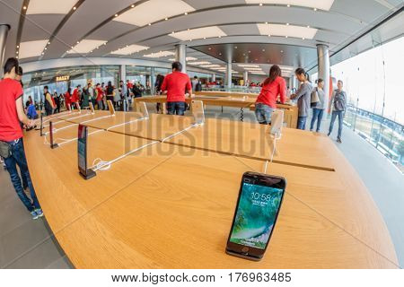 Hong Kong, China - December 4, 2016: Fish-eye view of Apple store interior, IFC Mall, Central District. Apple is a multinational corporation that produces consumer electronics, computers, software.