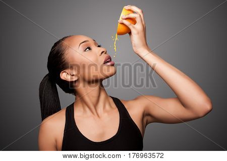 Happy Healthy Black Asian Woman Squeezing Orange Juice Fruit