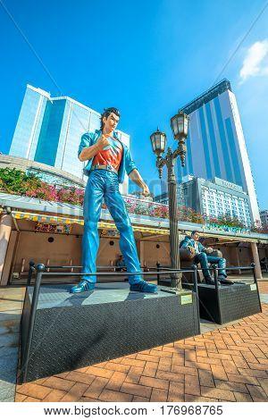 Hong Kong, China - December 5, 2016: Hui Lok and Wang Xiao Hu, statues of famous characters, in Hong Kong Avenue of Comic Stars, Kowloon Park, Tsim Sha Tsui. Sunny day.