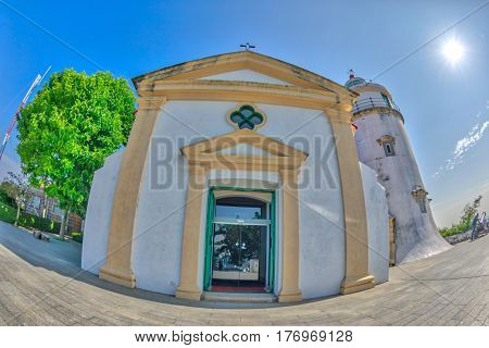 Fish-eye view of facade Guia Lighthouse, Fortress and Chapel in Historic Centre of Macau, China. Sunny day, blue sky. Front view.