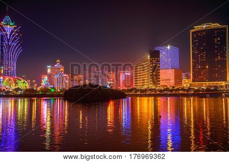 Macau, China - December 9, 2016: Cityscape of famous Casino mirroring in Nam Van Lake, a man-made lake in southern end of Macao Peninsula. The city has surpassed Las Vegas in terms of Casinos revenues