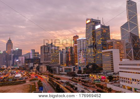Aerial view of cityscape of landmark buildings along the Lung Wo Road, a road between Central and Wan Chai district in Hong Kong island at sunset.