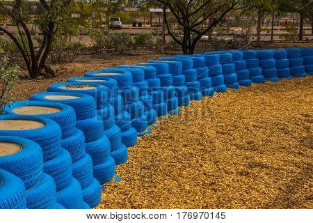 Blue Rubber Tires Used As Bumpers/Buffers At Children's Playground