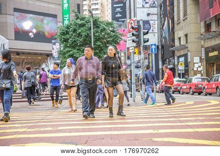 Hong Kong, China - December 6, 2016: Causeway Bay, the luxury shopping district. Asian couple shopping in Times Square, the largest shopping mall in Hong Kong.