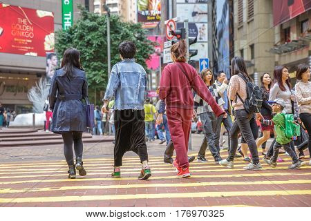 Hong Kong, China - December 6, 2016: asian women with child talking with people in Causeway Bay, one of the most attractive areas for tourists and business people and good for shopping.