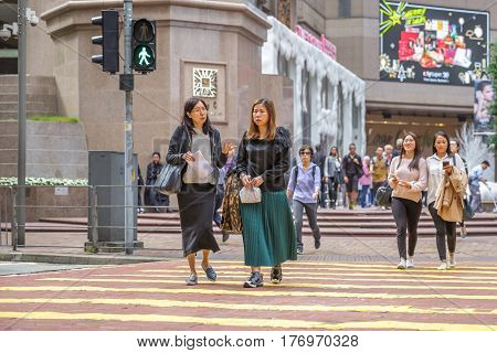 Hong Kong, China - December 6, 2016: asian couples of friends women outside the mall of Times Square, in luxury shopping district Causeway Bay.