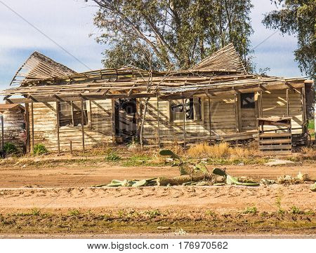 Abandoned Home In Disrepair & Roof Caving In
