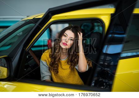 Close up of smiley woman in the car