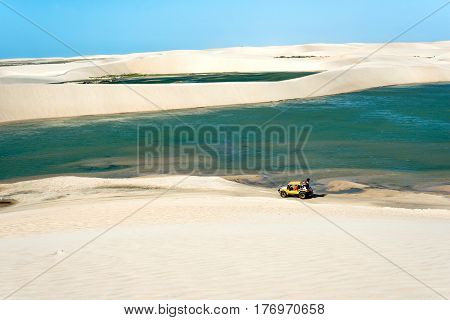 Jericoacoara, Ceara state, Brazil - July 17, 2016:  2016: Buggy with tourists traveling through the desert Jericoacoara National Park