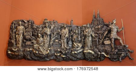 ZAGREB, CROATIA - MARCH 31: Bas relief with churches and patron saints of Kaptol the old part of Zagreb in Chapel of Saint Dismas in Zagreb, Croatia on March 31, 2015