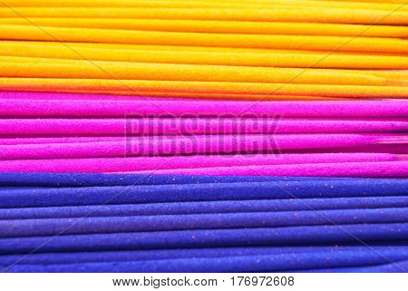 Closeup To Many Colorful Frankincense Sticks Background